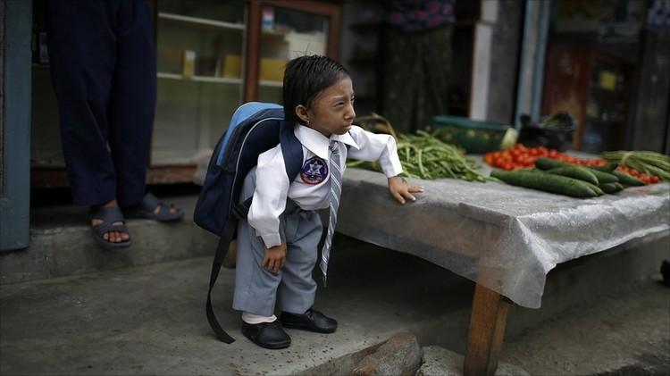 بالصور صور اصغر رجل في العالم ,صور لقذم عجيبه سبحان الله 1573 6