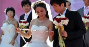 صور زواج جماعي , في حديقة هيديان في بكين