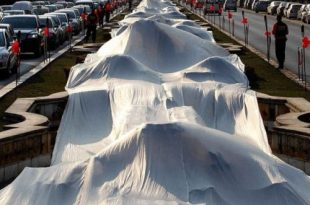 صوره اطول فستان زفاف في العالم , يدخل موسعة جينيس للارقام القياسبة